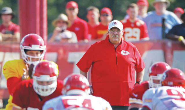Coach Andy Reid and the reigning Super Bowl champion Chiefs, shown at training camp last summer, opened this year by having rookies report on Tuesday to be tested for COVID-19 before being sent home. Charlie Riedel | AP file photo