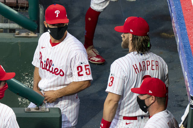 <p>Joe Girardi, left, talks with Bryce Harper prior to his debut as Phillies manager on Friday.</p> <p>Chris Szagola   AP photo</p>