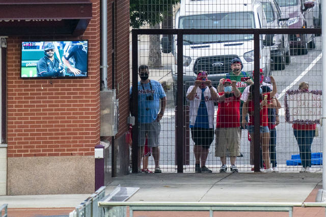 <p>Fans aren't allowed inside major league stadiums this season, but a handful watched from the gate outside of Citizens Bank Park just past center field during the first inning on Friday.</p> <p>Chris Szagola   AP photo</p>