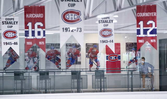 Montreal Canadiens general manager Marc Bergevin watches an NHL hockey practice at the team practice facility in Brossard, Quebec on Tuesday. AP photo