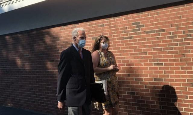 Jennifer Costello exits the West Pittston Municipal Building with her lawyer after being arraigned on Monday on identity theft and forgery charges. Kevin Carroll | Times Leader