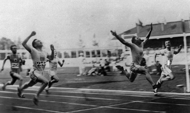 In this 1920 file photo, Charles (Charley) Paddock, second from right, of the USA wins the 100 meters final with his famous 'flying finish' at the 1920 Summer Olympics in Antwerp, Belgium. Morris Kirksey, far right, of the USA was second, and Jackson Scholz of USA, left, was fourth. Third place Harry Edward not shown. AP photo
