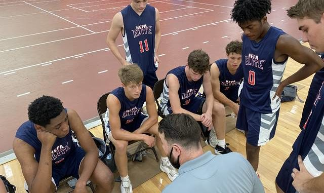 Abington Heights graduate Clay Basalyga huddles with the NEPA Elite 17U boys basketball team that he coached to two wins in its first three games.
