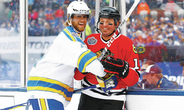 In this Dec. 31, 2016, file photo, former St. Louis Blues' Chris Pronger, left, laughs with former Chicago Blackhawks' Kyle Calder after a check during the Winter Classic alumni outdoor hockey game at Busch Stadium in St. Louis. Pronger insists there's no ill will after his surprising split with the Florida Panthers earlier in July 2020. Pronger, who was senior vice president of hockey operations, just decided the time was right to step away from the game, even with the Panthers making a playoff push, he said. AP photo