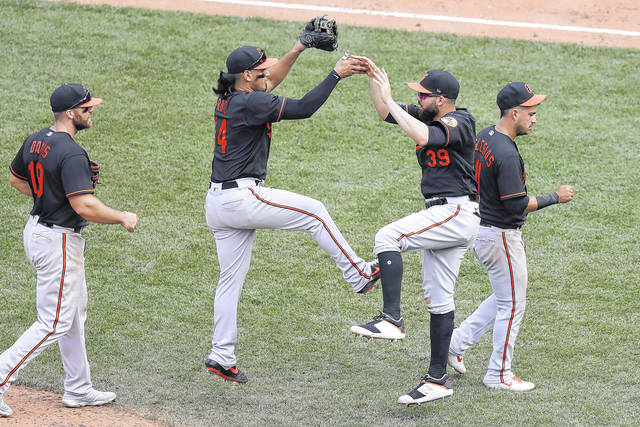 <p>The Baltimore Orioles' Rio Ruiz, center left, and Renato Nunez, center right, jump as they celebrate along with Chris Davis, left, and Jose Iglesias, right, following their win over the Boston Red Sox in a game on Sunday in Boston. (AP Photo/Steven Senne)</p>