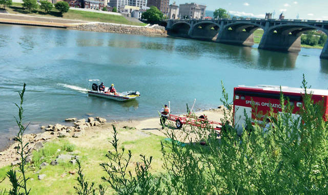 A Wilkes-Barre City Fire Department water rescue boat transports the body back to the boat launch at Nesbitt Park.                                  Kevin Carroll | Times Leader