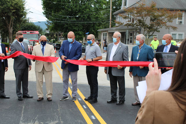 <p>Officials from Hanover Township, Luzerne County and Wilkes-Barre participate in a ribbon cutting ceremony Thursday to open the new Division Street bridge on the border of the township and Wilkes-Barre.</p> <p>Jerry Lynott | Times Leader</p>