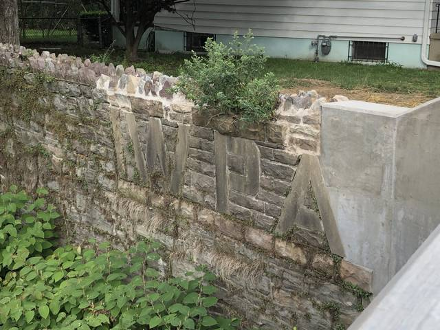 <p>The new Division Street bridge on the border of Hanover Township and Wilkes-Barre contains a piece of the old one, the cornerstone plaque with the letters of the Works Progress Administration, the Depression-era federal agency responsible for public infrastructure projects.</p> <p>Jerry Lynott | Times Leader</p>