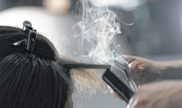 Steam rises as a hair stylist works on a model prior to a show displaying the Tom Ford collection during Fashion Week in New York. People of color in the industry trace bias and discrimination in predominantly white salons to the sidelining of formal education focused on Black hair. Horror stories are not uncommon, from outright refusal of service to botched treatments and cuts by stylists who don't know what they're doing. AP photo