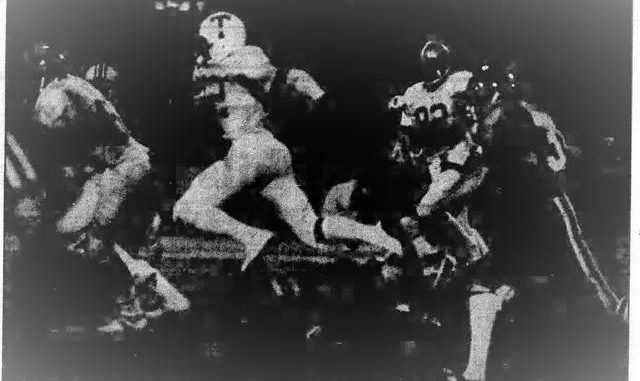Nanticoke Area's Harry Hamilton follows a block from Coughlin's Ron Solt during the Big 33 Game at Wilkes-Barre Memorial Stadium in 1980. Organizers wanted the game back the following year, but it was awarded to Hershey.                                  Times Leader file photo