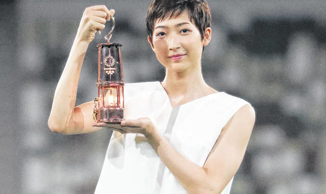 Japanese swimming athlete Rikako Ikee holding the lantern containing Olympic flame poses during a photo session at the Olympic Stadium in Tokyo. Friday, July 31, would have been the seventh full day of the postponed Tokyo 2020 Olympics; almost the halfway point. The focus is now entirely on how to pull off the games next year, in what still might be the middle of a pandemic. AP photo