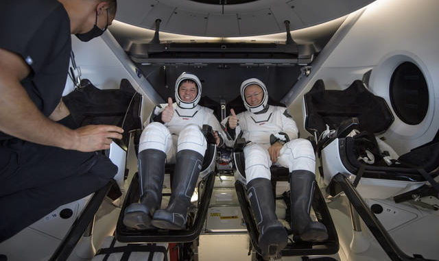 NASA astronauts Robert Behnken, left, and Douglas Hurley are seen inside the SpaceX Crew Dragon Endeavour spacecraft onboard the SpaceX GO Navigator recovery ship shortly after having landed in the Gulf of Mexico off the coast of Pensacola, Fla., Sunday, Aug. 2, 2020. The Demo-2 test flight for NASA's Commercial Crew Program was the first to deliver astronauts to the International Space Station and return them safely to Earth onboard a commercially built and operated spacecraft. Behnken and Hurley returned after spending 64 days in space. Bill Ingalls | NASA via AP