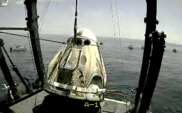 """<p>In this frame grab from NASA TV, the SpaceX capsule is lifted onto a ship, Sunday, Aug. 2, 2020 in the Gulf of Mexico. Astronauts Doug Hurley and Bob Behnken spent a little over two months on the International Space Station. It will mark the first splashdown in 45 years for NASA astronauts and the first time a private company has ferried people from orbit.</p> <p>NASA TV via AP</p> <p>""""></p> <p>In this frame grab from NASA TV, the SpaceX capsule is lifted onto a ship, Sunday, Aug. 2, 2020 in the Gulf of Mexico. Astronauts Doug Hurley and Bob Behnken spent a little over two months on the International Space Station. It will mark the first splashdown in 45 years for NASA astronauts and the first time a private company has ferried people from orbit.</p> <p>NASA TV via AP</p> <p> <img src="""