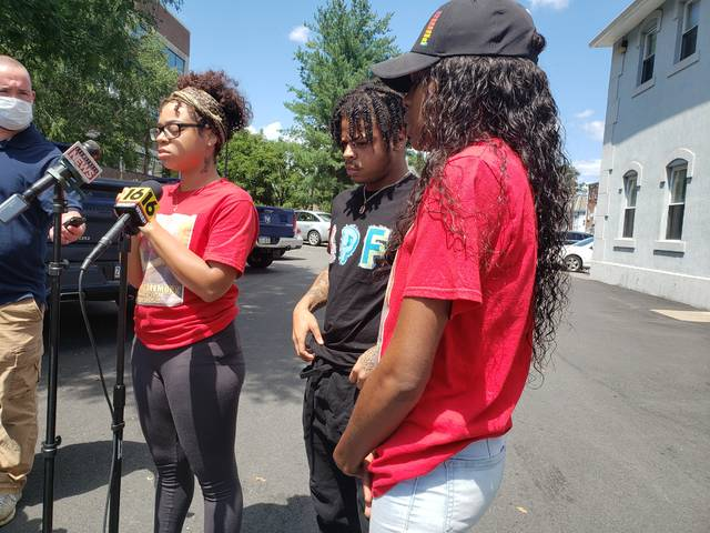 Tatiyanee Mackey, left, Shaheen Mackey Jr., and Chareina Blanding, niece of Shaheen Mackey, speak with members of the media on Wednesday after the release of a video showing Shaheen Mackey being restrained at the Luzerne County Correctional Facility in June 2018, two days prior to his death.                                  Patrick Kernan | Times Leader