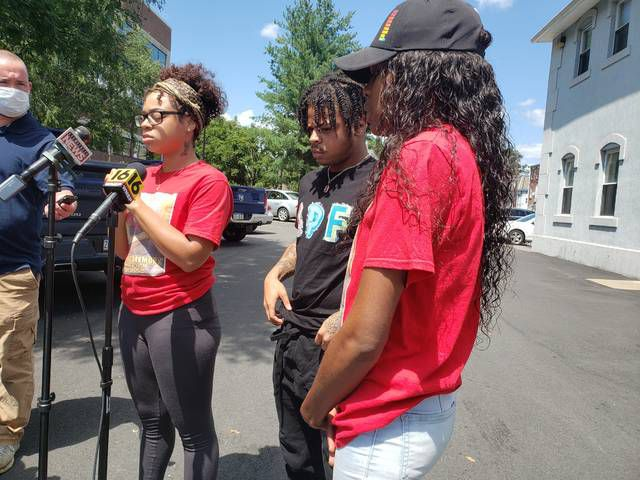 Tatiyanee Mackey, left, Shaheen Mackey Jr., and Chareina Blanding, niece of Shaheen Mackey, speak with members of the media on Wednesday after the release of a video showing Shaheen Mackey being restrained at the Luzerne County Correctional Facility in June 2018, two days prior to his death.                                  Patrick Kernan   Times Leader