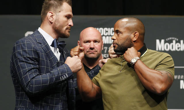 Stipe Miocic, left, and Daniel Cormier pose during a news conference for UFC 226 in Las Vegas.