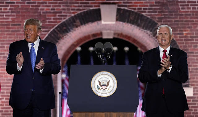 Vice President Mike Pence stands on stage with President Donald Trump after Pence spoke on the third day of the Republican National Convention at Fort McHenry National Monument and Historic Shrine in Baltimore on Wednesday. Andrew Harnik | AP photo