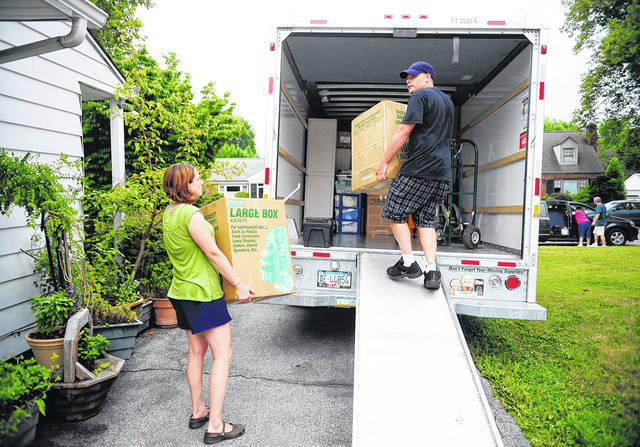 People load a U-Haul truck with boxes while they prepare to move in York. Many have had to reconsider their living situation because of the pandemic. Before you decide to relocate, make a budget to account for moving costs and the cost of living in your new location.                                  AP photo