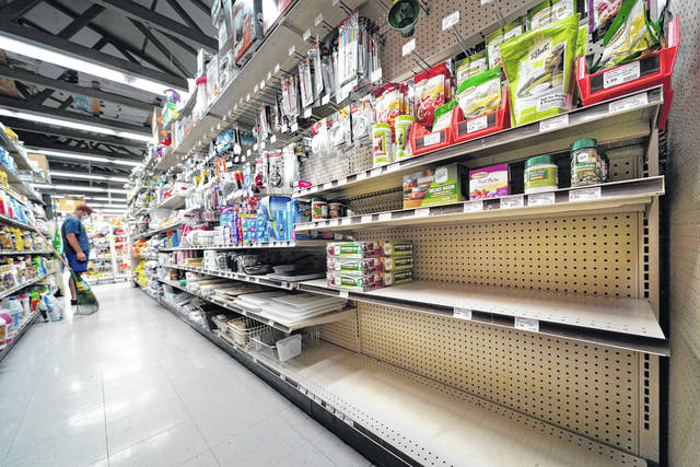 Shelves that are usually stocks with Mason jars and lids in the canning supply section are mostly empty at the Drillin True Value hardware store in South Portland, Maine. During this ongoing coronavirus pandemic many retailers have been frustrated by the scarce supply of jars and lids used for canning vegetables.                                  AP photo