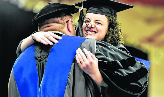 Stephanie Helsel hugs then-university president Thomas Botzman after recieving her philosophy degree at Misericordia University graduation on the Dallas campus in 2018. Misericordia University came in at 206 out of nearly 400 national universities in U.S. News and World Report's Best Colleges ranking of American colleges and universities. Read the story to see how other area institutions fared.                                  Times Leader file photo