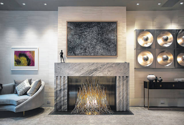 This photo provided by Elena Colombo shows a fire feature in a New York home designed by Colombo. In the evening, the warm light from a fire feature like this one can change the mood in a home that's been used for work and school during the day.                                  AP photo