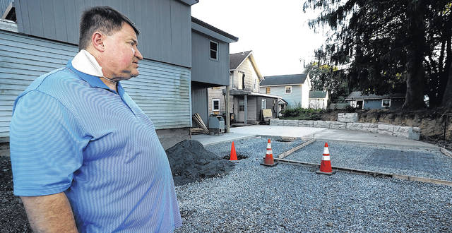 <p>Michael Holcomb checks on the progress of what will be a patio dining area in the rear of his establishment in West Wyoming.</p>                                  <p>Fred Adams | For Times Leader</p>