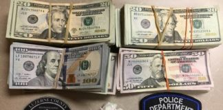 A digital scale, packaging materials and more than $12,520, some of which is seen here, were found Monday during the search of a Hanover Township residence, authorities say.                                  Via Hanover Township police