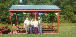 Jareth Jungermann, second from left, poses with his Scoutmaster and grandfather, Herbert King, and his parents, Janet and Brandon Jungermann, at the outdoor area at the Marian Sutherland Kirby Library that he renovated for his Eagle Project.                                  Submitted photo