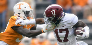 Alabama wide receiver Jaylen Waddle pushes away Tennessee defensive back Kenney Solomon during an NCAA football game in Knoxville, Tenn., on Saturday.                                  AP photo