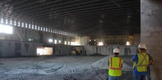 The gym of the new Wilkes-Barre Area High School, with the second floor running track visible in the background, is seen under construction earlier this year in a file photo. Stressing the issue did not involve subsurface problems or work on concrete footers already underground, Wilkes-Barre Area School District Solicitor Ray Wendolowski explained that agreements with three new companies on the new high school construction project are in response to discovery of some cracking in load-bearing walls.                                  Times Leader file photo