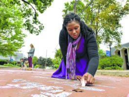 Wyoming Seminary student Victoria Morrison of Forty Fort writes a message in chalk on Sprague Avenue in Kingston for the Pink Ribbon project during a previous Breast Cancer Awareness Month in this file photo. Those who have lost income or health insurance because of COVID-19 may qualify for free breast and cervical cancer screening and diagnostic services under the Pennsylvania Breast & Cervical Cancer Early Detection Program.                                  Times Leader file photo