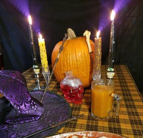 Our Times Leader test cooks tried to set up a bewitching display, fit for a party. Look closely and you'll see wands, a skull-shaped bottle, a peaked hat, a real pumpkin and seasonal candles. Our edible offerings include Halloween Pizza, in the foreground, and Pumpkin Juice, in the mug.                                  Mark Guydish | Times Leader
