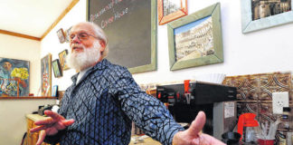 Kendal Hancock, owner of the Renaissance Fine Arts & Coffee House in Sugar Notch, offers his customers a bit of art and history along with coffee.                                  Fred Adams | For Times Leader