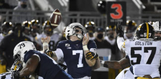 Will Levis has the ball knocked loose on a sack for one of Penn State's four turnovers between its two quarterbacks on Saturday against Iowa.                                  Barry Reeger | AP photo