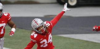 Ohio State defensive back Shaun Wade celebrates his interception and touchdown against Indiana during the second half of an NCAA college football game Saturday, Nov. 21, 2020, in Columbus, Ohio. Ohio State beat Indiana 42-35. (AP Photo/Jay LaPrete)
