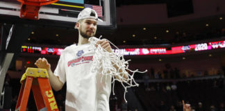 In this March 10, 2020, file photo, Gonzaga's Killian Tillie (33) cuts down the net after defeating Saint Mary's in an NCAA basketball game in the final of the West Coast Conference men's tournament in Las Vegas. As more than 300 teams prepare to start a season that will look nothing like any before it, the conversation is not so much about who will be cutting nets at the end of March Madness, as whether anyone will cut nets at all.                                  AP photo