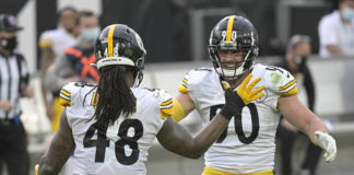 Pittsburgh Steelers linebacker Bud Dupree (48) and linebacker T.J. Watt, right, celebrate a big play against the Jacksonville Jaguars during the second half of an NFL game Sunday in Jacksonville, Fla.                                  AP photo
