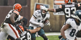 Philadelphia Eagles quarterback Carson Wentz (11) is sacked by Cleveland Browns defensive end Olivier Vernon (54) during the second half of an NFL game Sunday in Cleveland.                                  AP photo