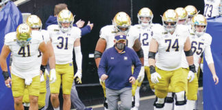 Notre Dame and coach Brian Kelly, center, are behind only No. 1 Alabama in the first College Football Playoff rankings, which were released Tuesday night.                                  Keith Srakocic | AP file photo