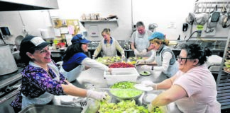 Volunteers prepare salads for Thanksgiving meals at St. Vincent De Paul Kitchen in Wilkes-Barre in this file photo. Catholic Human/Social Services of the Diocese of Scranton will provide free, takeout Thanksgiving meals Thursday at two locations, including this one.                                  Times Leader photo