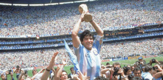Diego Maradona celebrates after Argentina's 3-2 victory over West Germany at the World Cup final on June 29, 1986, at Atzeca Stadium in Mexico City. The soccer great died from a heart attack on Wednesday.                                  Carlo Fumagalli | AP file photo