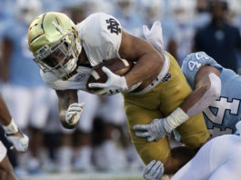 North Carolina's Jeremiah Gemmell (44) stops Notre Dame's Kyren Williams during the first quarter of a college football game Friday in Chapel Hill, N.C.                                  AP photo