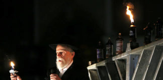 Rabbi Zvi Perlman of Kingston says a few words to the crowd on Public Square in Wilkes-Barre before lighting the first candle on the Menorah to mark the seventh day of Hanukkah in 2019. Hanukkah began last Thursday and ends this Friday evening.                                  Times Leader file photo