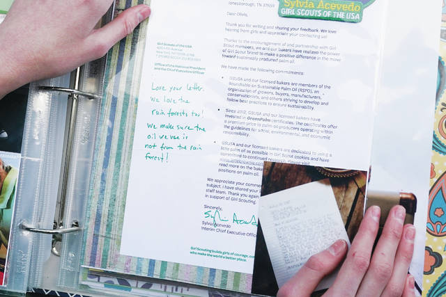 <p>Olivia Chaffin displays a 2017 response she received from the chief executive officer of the Girl Scouts to her concerns with palm oil being used in Girl Scout Cookies in Jonesborough, Tenn.. 'I thought Girl Scouts was supposed to be about making the world a better place,' she said. 'But this isn't at all making the world better.'</p>                                  <p>AP photo</p>