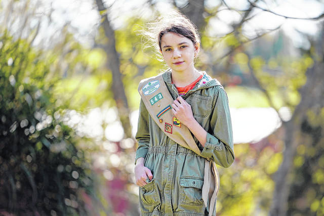 <p>Olivia Chaffin, 14, stands for a portrait with her Girl Scout sash in Jonesborough, Tenn. Olivia is asking Girl Scouts across the country to band with her and stop selling cookies, saying, 'The cookies deceive a lot of people. They think it's sustainable, but it isn't.'</p>                                  <p>AP photo</p>
