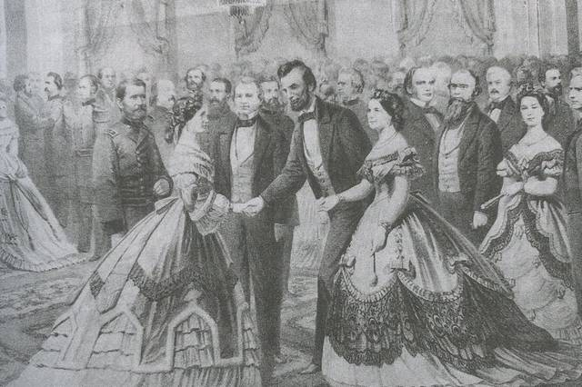 <p>This lithograph shows General Ulysses S. Grant and Julia Grant being greeted by President Abraham Lincoln and Mary Todd Lincoln at a White House reception, circa 1865. The image is one of many that appear in the book 'Symbols of Patriotism.'</p>