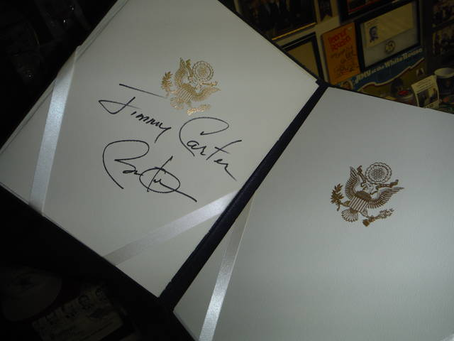 <p>History buff Laurence L. Cook treasures the autographs of Jimmy Carter, top, and Barack Obama.</p>