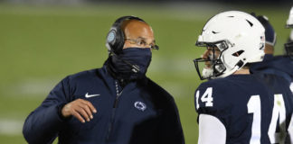 Penn State coach James Franklin was concerned with the development of Sean Clifford (14) and his quarterbacks in 2020, which factored into his decision to switch offensive coordinators this month.                                  Barry Reeger | AP file photo