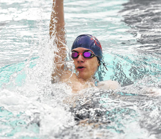 Jacob Gregory, a junior swimmer at Pittston Area, swims against the clock during a virtual swim meet against Holy Redeemer on Thursday afternoon in Yatesville.                                  Tony Callaio   For Times Leader