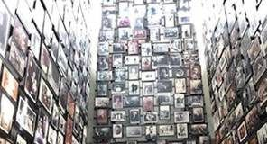 At the Holocaust Memorial Museum in Washington, a group of students stands on a walkway that passes through a three-story gallery of photos of Holocaust victims.                                   File photo